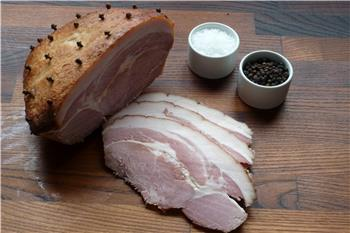 Cooked glazed picnic ham joint